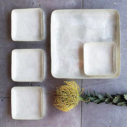 Hip To Be Square Dishes - These days, it's oh, so cool to be a square. And square dishes? Even cooler. These milky-colored dishes and tray will make your meals even more memorable.