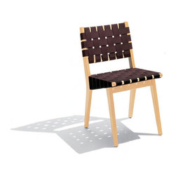 """Knoll � - Risom Side Chair with Webbed Back - Back in 1941, Danish designer Jens Risom created an exclusive collection for Knoll. Today, the entire collection, including the suave-looking Risom Side Chair's unique and modern design is just as relevant as ever. Working a lot with wood, Risom's signature style clearly comes through in this fun and modern side chair. The Design Part of a larger collection, designed in 1941--the Risom Side Chair incorporates a natural aesthetic, characteristic of understated Scandinavian design. The side chairs are made of maple and cotton or nylon webbing and look great in any setting. Set them up in your dining room or office to achieve a polished ambience. Coming in a variety colors, the Risom Side Chair is easily adaptable to your taste and personal style. Not only will these stylish side chairs look fabulous in your home, but they also give you peace of mind--Risom Side Chairs are GREENGUARD Indoor Air Quality Certified. *This product is made to order and thus customer orders cannot be canceled once the products go into production Features at a Glance: Design Year: 1941 Features -Mortise and tenon construction. -Upholstered in choice of cotton or nylon/cotton blend. -Cotton webbing 100% natural cotton. -Nylon webbing is 60% nylon, 40% cotton with stain-protective finish. -Available with either an open or webbed back Dimensions: -Seat Height: 17.75"""" H . -Overall Dimensions: 30.63"""" H x 17.25"""" W x 18"""" D. Order with Confidence: . -Sustainability Statement: Sustainable design is a key component of Knoll's environmental focus. Knoll's commitment to social responsibility and a healthy environment has prompted the company to further articulate its longstanding environmental programs and, with encouragement and support from colleagues in the industry, Knoll has re-energized its focus on such """"green"""" initiatives as life cycle analysis and LEED certification. Knoll is proud to have contributed to projects that have received LEED certification"""