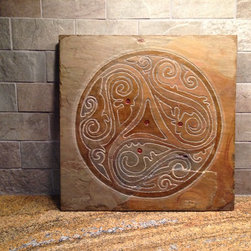 "Art Gallery Exhibition- ""Free Spirit"" Artisan Tile: Corporate Conference Center - ""free spirit"" geometric artisan tile symbolizing energy and vitality. Natural oils are added to accentuate the design and bring out colors inherent in the stone."
