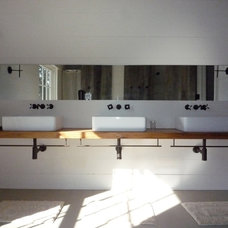 Farmhouse Bathroom by Pursley Dixon Architecture