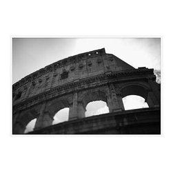 """Michal Venera Framed Print, Coliseum I, No Mat, 28 x 42"""", White - On first glance, these iconic images of Rome are striking for their lush sepia tones, rich detail and intriguing camera angles. A closer look reveals the beauty of patterns, whether it is hundreds of stones that make up an old street, arches in the coliseum or the remaining three columns of a ruin. All exude a sense of order and timelessness amid the ever-changing landscape of city and country. 13"""" wide x 11"""" high 20"""" wide x 16"""" high 42"""" wide x 28"""" high Alder wood frame. Black or white painted finish; or espresso stained finish. Beveled white mat is archival quality and acid-free. Available with or without a mat.{{link path='shop/accessories-decor/pb-artist-gallery/artist-gallery-michal-venera/'}}Get to know Michal Venera.{{/link}}"""