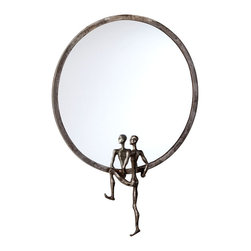 Kobe Mirror #2 - A looking glass that looks like art. The Kobe Mirror #2 features a simple round frame of Raw Steel with a sculpted human form that appears to be holding the mirror up for display. Boldly imaginative, the mirror invites one to reflect on this dramatic melding of the practical and the beautiful.
