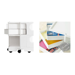 Modern Office Furniture: Desk Organizer - Part of our modern office furniture collection, the Joe Colombo office organizer fits neatly under an office desk where it can be used to store just about anything: printing paper, paperclips, tape, pens, calculator, stickers, post-it notes, rubber bands, magazines, stapler, etc.  A great organizer for business and home office.  Compact enough to fit underneath an office desk.  This stylish home office cart is one of the most functional items to have around your office. Increased organization leads to increased productivity, and that is what this practical mobile storage cart is all about. And, it's beautiful too. Shelves flip open and provide easy and almost dust-free storage of documents, keys, office supplies, etc. The vertical plastic top can be removed so tubes can be stored in it as well, making it a perfect tool for architects, designers or artists. The Boby Trolley has casters as well, no need to lift, just roll it from one place to the next. Sturdy as well, this is made of superior grade plastic which is almost indestructible. This storage trolley works wonders in the home and office. It simplifies life, keeps things organized and it is a must-have for both home- and office environments. A piece of Modern Art for everyday use at a price that won't break the bank. What more can you ask for?   It is also perfect when used as a bedside table.  Check our amazing selection for all your home office needs featuring office storage solutions, office furniture, office chairs, storage cabinets, storage furniture, file storage and office cabinets.  Available from stardust.com: http://www.stardust.com/B22.html