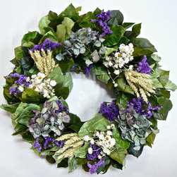 "Frontgate - Greenbrook Wreath - 22"" - Made with all-natural, air-dried materials. Designed for indoor display. Extend the life of floral materials by keeping it away from direct sunlight and moisture. A decorative classic, Meadowbrook recalls the rolling gardens of the English countryside. Carefully arranged bundles of dried hydrangea, purple sinuata statice, white ammobium, and golden-green wheat nestle into a base of preserved and air-dried salal leaves for a composition fit for most any room, and any style of decor.. . ."