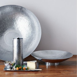Hammered Entertaining - Serveware - Made in India using traditional metalworking techniques, these hand hammered-metal serving pieces bring unique texture, shape and shimmer anywhere they go. This versatile collection includes pieces that fit various needs: The Large and Footed Bowls are perfect for fruit, while the Oversize Bowl makes a grand centerpiece. The various trays can be used for serving drinks or canapés or to organize and display keepsakes and odds and ends atop a dresser or nightstand, end or coffee table or console.