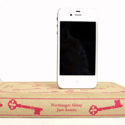 Jane Austen's Northanger Abbey Booksi by Rich Neeley Designs - What a clever way to keep cords and cables hidden and your iPhone charged and accessible. This Etsy find comes in various book and color choices.