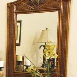 Hospitality Rattan - Cancun Palm Mirror - Showcase your casual, island inspired style with this decorative wood and woven wicker wall mirror, perfect for a beachfront cottage or ideal for bringing the spirit of the beach into any space. The mirror is available in your choice of finish options. A coordinating dresser is sold separately. This product is warranted for indoor use. Made of Wood Frame and Woven Wicker. Traditional wicker mirror. Finished in TC Antique Color. Durable, yet elegant construction and matches Cancun Palm Seating, Dining, Bar Stool Items as well. Wood frame construction. Coordinates with other bedroom pieces from the Cancun Palm collection. Tropical island style design with palm tree decor. Pictured in Antique. Fully assembled. 35 in. W x 2 in. D x 45H (26 lbs.)This Cancun Palm bedroom collection is one of our exclusive and largest collections of fine rattan and herringbone wicker weaving. That has a fiber palm tree castings design. The woven leather bindings used throughout Cancun Palm ensures its durability and quality for many years of use. It enhances the tropical look in any bedroom room. The selection of two finishes help compliment any room decor. In addition metal glides are used on all the case good pieces along with glass which is included on the Cancun Palm Collection.