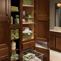 Homecrest Tall Linen Hamper Cabinets - A place for everything. Homecrest cabinets have organization solutions for every room . The Tall Linen Hamper Cabinet keeps toiletries off the counter and dirty towels off the floor.