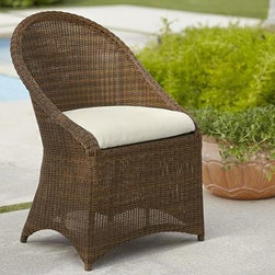 "Palmetto All-Weather Wicker Dining Chair, Honey - Crafted of a rugged synthetic that captures the beauty of wicker, our Palmetto dining chair can be left outdoors year round. Click to read an article on {{link path='pages/popups/palmetto-care_popup.html' class='popup' width='640' height='700'}}recommended care{{/link}}. 24"" wide x 25.5"" deep x 35"" high Woven from slender honey strands that are variegated to replicate wicker's rich texture. Synthetic fibers are superbly weather resistant. Styled with a full apron and arched back. Includes a quick-drying seat cushion and a water-repellent polyester canvas slipcover in Natural; imported Get a colorful update with additional slipcovers (sold separately) in water-repellent, ring-spun polyester canvas, or fade and stain-resistant Sunbrella(R) fabric; imported. Sunbrella(R) cushions and slipcovers are special order items which receive delivery in 34 weeks. Please click on the shipping tab for shipping and return information. Watch a video about why our {{link path='/stylehouse/videos/videos/pbq_v31_rel.html?cm_sp=Video_PIP-_-PBQUALITY-_-PALMETTO_COLLECTION' class='popup' width='950' height='300'}}Palmetto Collection{{/link}} is ideal for the outdoors. View our {{link path='pages/popups/fb-outdoor.html' class='popup' width='480' height='300'}}Furniture Brochure{{/link}}."