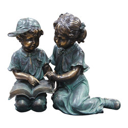 Alpine Corporation - Boy and Girl Reading Together Statue - This antique finish sculpture has a timeless charm that captures the innocence of childhood. The intricate detailing of these children is sure to bring a whimsical playfulness to your garden or deck.