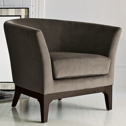 Tulip Upholstered Chair - A chair that wants to wrap you in its arms. The curvy silhouette and casually comfortable upholstery make it a haven for reading and relaxing.