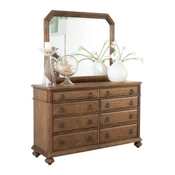 American Drew - American Drew Grand Isle Dresser with Mirror in Amber - The Grand Isle collection is a lifestyle bedroom and dining room group that offers high end, yet casual up to date tropical style with multiple options for any room of the home; creating a collection that is perfect for many homes, vacation homes or even smaller size vacation condos. The amber finish has a warm overtone with subtle dark burnished accents that make the natural soft distressing show through. Design elements used in Grand Isle include carved and shaped pilasters, woven drawer fronts and a louver motif; all adding a higher end look to the collection. This collection is sure to add a relaxed, yet sophisticated style to most homes and offers plenty of options to help with storage and organization.