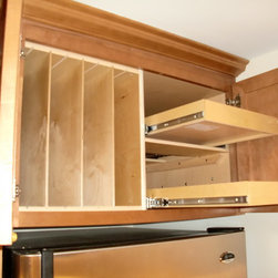 ShelfGenie Over the Fridge/Oven Solutions - Make better use of the cabinet above your refrigerator with a combination of pull out shelves next to dividers that neatly store cutting boards, baking trays, platters and more!