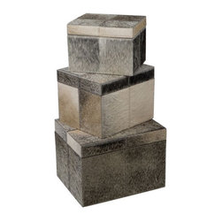 Set of 3 Faux Pony Nesting Boxes - Exotic animal prints, hide rugs and faux fur throws are trending. I love the look, but a little animal print goes along way. I love these faux pony nesting boxes and think they would look so chic in a modern office or eclectic living room.