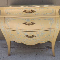 SOLD!! Bombe Chest, French Provincial - Classic French provincial style piece! Bombe style (often misspelled bombay) bowed front drawers, hand painted blue and white flowers and swags on wheaty gold background, gold French provincial drawer pulls, 3 drawers.