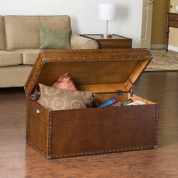 Southern Enterprises Inc. - Steamer Trunk Cocktail Table - Crafted to look like a beloved family heirloom, this steamer trunk coffee table is ideal as a decorative, yet functional accent. The convenient storage under the lid is sure to help clear the clutter.