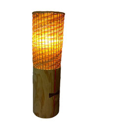 Bamboo And Wood Table Lamp - This table lamp is thoughtfully made with bamboo lampshade and salvaged wood as its base. No two of these lamps are alike. The bamboo lampshade is carefully weaved around the wooden base. The finished lamp has a rustic look and creates a natural and pleasing atmosphere perfect for any living room or bedroom.