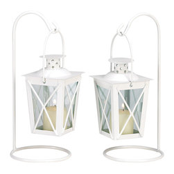 Anzy - White Railroad Candle Lanterns - Quaint mini-lanterns recall the romance of the railroad; styled just like the signal lanterns that lined the tracks in the glory days of rail travel.     These cute candle lanterns get a modern update from a bright white enamel finish, adding just the right festive touch to your next outdoor celebration!