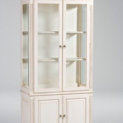 Pierre Curio Cabinet - Display your cherished memories here. This beautifully built piece has beveled glass upper doors and side panels. Designed with classic simplicity, it has raised panels on the sides and lower doors, with room on bottom to store favorite treasures.