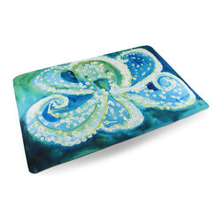Zeckos - Betsy Drake Colorful Octopus Comfort Floor Mat 18 In. x 26 In. - Add a pop of aquatic charm to the floor by the shower, the front door or kitchen with this colorful floor mat featuring a peppy green octopus happily swimming in the deep blue sea. Made of synthetic washable materials, it's sure to give you years of enjoyment while the non-slip rubber backing helps keep it in place, and the 1/4 inch thickness provides comfort and relief while standing. Measuring 18 inches (46 cm) wide and 26 inches (66 cm) long, it's great for a pool area, laundry room or next to the bed or closet in a bedroom, and would make a wonderful housewarming gift