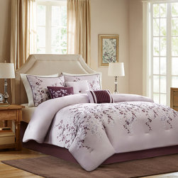 Home Essence - Home Essence Grace 7 Piece Comforter Set - Grace collection is the perfect bed for a room that wants to look updated and modern. The comforter and sham features a beautiful floral pattern that is embroidered on a light purple microfiber ground and is finished with a dark purple flat piping detail. A bedskirt features a solid dark purple color made of soft brushed microfiber. The set includes three decorative pillows to complete the whole look. Comforter & sham face: 100% polyester micro fiber 75gsm print pieced with embroidery, reverse: polyester microfiber 75gsm solid. Comforter with 250gsm poly fill. Pillows: 100% polyester cover with poly fill; Bedskirt: non woven platform and micro fiber 75gsm drop