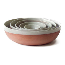 18KARAT - Terrra Bowls Set - The Terra kitchen collection speaks of the earth with raw clay left exposed on the bottom of each piece. A loosely applied light mint glaze finishes the pieces making them durable, microwave safe and dishwasher safe.