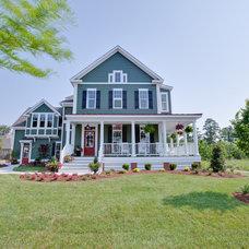 Farmhouse Exterior by Architectural Designs