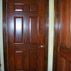 custom faux woodgrain - this is a fire rated garage door that has been painted to look like mahogany.  the customer has beautiful woodwork throughout and the door was matched to the woodwork. this technique can be replicated on anything.