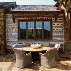 Rustic Patio by DK Design