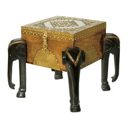 "Everybody's Ayurveda - Small Carved Elephant Table in Wood and Metal - Small Elephant Carved Table with Storage Compartment. Wood and Metal. Made in India. 8"" Wide x 8"" Deep x 8"" Tall. Hand crafted in Mango Wood, this eclectic table can be used as a side table with storage! Accented with antiqued brass, this table features feet carved into elephants! Store coasters, games and more! Compliments and can be stacked with our Medium and Large Elephant Table!"