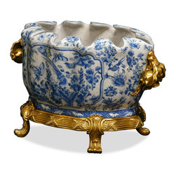 China Furniture and Arts - Hand Painted Ormolu Flower Bowl - The sheer beauty of this 18th century-inspired blue and white fruit bowl is further emphasized by antiqued brass plums by its sides and lion's feet stand. Hand painted on crackle glazed porcelain. A gorgeous centerpiece on its own. Entirely handcrafted.