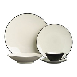 Kita 20-Piece Dinnerware Set - Pure and simple. Clean Asian shapes have a thin, elegant feel and sophisticated color palette of subtle celadon and matte black. Porcelain is fired at a very high temperature, with the cooling process creating the beautiful crackling of the glossy glaze. This traditional artistic effect is food safe, though it may discolor when exposed to foods that can potentially stain until it is cleaned in an automatic dishwasher.