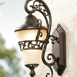 Frontgate - Small Anastasia Wall Sconce - Sturdy cast-aluminum construction designed for years of service. Hand-applied finishes will gain an even richer character with time. Professional installation recommended for hard-wired lighting. Our Anastasia Outdoor Lighting features sweeping curves and a graceful teardrop design. Hammered glass renders these outdoor lights an eye-catching addition to your home's exterior. . . .