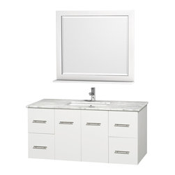 Wyndham Collection - 48 in. Vanity Set in White Finish - Includes matching mirror with shelf. Faucets not included. Four functional drawer. Two functional door. Plenty of counter and storage space. Brushed chrome exterior hardware finish. Single faucet hole mount can be drilled for 3-hole faucets on site. Concealed soft-close door hinges. Fully-extending under-mount soft-close drawer slides. Deep doweled drawers. Unique and striking contemporary design. Highly water-resistant low V.O.C. sealed finish. 12-stage wood preparation, sanding, painting and finishing process. Lifetime warping prevention. Square porcelain undermount sink. White Carrera top. Made from solid oak wood. Vanity: 48 in. W x 21.5 in. D x 22.75 in. H. Mirror: 36 in. W x 5 in. D x 33 in. H. Handling Instructions. Assembly Instructions - Vanity. Assembly Instructions - Countertop. Assembly Instructions - Sink. Assembly Instructions - MirrorSimplicity and elegance combine in the perfect lines of the Centra vanity by the (No Suggestions) collection. If cutting-edge contemporary design is your style then the Centra vanity is for you - modern, chic and built to last a lifetime. Available with green glass, pure white man-made stone, ivory marble or white Carrera marble counters, and featuring soft close door hinges and drawer glides, you'll never hear a noisy door again! Meticulously finished with brushed chrome hardware, the attention to detail on this beautiful vanity is second to none.