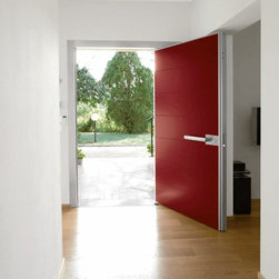 Synua by Oikos (Made in Italy) - The door has a vertical lever opening mechanism with two fully adjustable and retractable (lower and upper) pins acting as a fulcrum. The door rotates on itself, to allow easy and generous access and leave light to enter on either side.