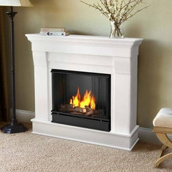 """Real Flame 5910-W Fireplace Indoor Gel Fuel Chateau White - Real Flame Chateau Ventless Gel Fireplace, White - 5910-WProduct Features The Chateau Fireplace features the clean lines and classic stylingfamiliar to stone mantels, realized in wood. In three great finishes, this design is sure to compliment a variety of d?cor, from classic to contemporary. The hand-painted log set and bright crackling flame add to the realistic look of this Real Flame Gel Fuel Fireplace. Uses 3 - 13oz. cans of Real Flame Gel Fuel. Available in Espresso, White, or Dark Walnut finishes. * Includes: Mantel, Firebox, Hand Painted Cast Concrete Log, And Screen Kit * Solid wood and veneered MDF construction * Uses Only Real Flame 13oz Gel Fuel Cans, sold separately * Assembly Required * Available in Espresso, White and Dark Walnut finishes. * Uses clean burning Real Flame Gel fuel emitting up to 9,000 BTUs of heat per hour lasting up to 3 hours * Product Dimension: 37.6"""" H X 40.9"""" W X 11.8"""" DReal Flame: Ventless Gel, fireplaces and accessoriesFor nearly 30 years Real Flame has been the leader in the production and sale of gel-fueled fireplaces and accessories. All of Real Flame products are manufactured to the highest standards and, of course, safety is the top priority in all of the designs.Real Flame Gel Fuel is an exclusive premium alcohol based blend that requires no ventilation when burned. No chimney, no gas hookups and no electricity needed. Makes an ideal addition to any room in all types of homes adding the warmth and ambience of a real fire without the hassle and expense of costly installations.Tested and approved for indoor and outdoor use, Real Flame Gel Fuel meets all clean air requirements established by both OHSA and the EPA.Join the thousands of satisfied customers across the country and begin your own memories from evenings around the fire today."""