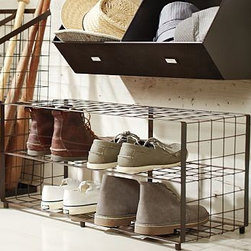 "Kellan Shoe Rack - Create a clutter-free work space with our Kellan Shoe Rack. Crafted from durable steel with a deep bronze finish, this smart design provides tiered storage on sturdy wire shelves. 30"" wide x 11.5"" deep x 13.5"" high Crafted of steel with a rustic bronze finish."
