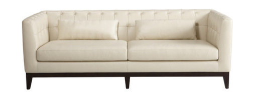 "Sunpan Modern - Randolph Grain Leather Sofa - Features: -Material: Solid wood and top grain leather.-Classically designed yet contemporary.-High density foam and natural fibers.-Stocked in 100% top grain leather.-With a PVC back.-Pillows included as shown.-Please note that although every attempt has been made to ensure accuracy, all dimensions are approximate.-Collection: Randolph.-Frame Finish: Espresso.-Distressed: No.-Powder Coated Finish: No.-Gloss Finish: No.-Frame Material: Hardwood.-Upholstery Material: Leather.-Solid Wood Construction: Yes.-Number of Items Included: 1.-Water Resistant: No.-Fire Resistant: Yes.-Scratch Resistant: No.-Stain Resistant: No.-Mildew Resistant: No.-Fade Resistant: No.-Tear Resistant: No.-Style: Transitional.-Pattern: Solid.-Cushion or Upholstery Fill Material: Foam.-Foam Density: 2.1 lbs per cubic foot.-Welt on Cushions: Yes.-Tufted Cushions: Yes.-Rocker: No.-Massage: No.-Reclines: No.-Legs Included: Yes -Removable Legs : No.-Leg Material : Wood.-Leg Finish: Espresso.-Leg Glides : Yes..-Adjustable Headrest: No.-Nailhead Trim: No.-Cupholders: No.-Skirted: No.-Arm Style: Track Arms.-Back Style: Tight Back.-Slipcovered: No.-Storage: No.-Console Included: No.-Seating Comfort: Medium.-Outdoor Use: No.-Seating Capacity: 4.-Swatch Available: Yes.-Application: Both Commercial and Residential.-Recycled Content: No.Dimensions: -Overall Height - Top to Bottom: 28"".-Overall Width - Side to Side: 80.5"".-Overall Depth - Front to Back: 36"".-Seat Height - Top to Bottom: 17"".-Arms: -Arm Height - Top to Bottom: 28""..-Legs: -Leg Width - Side to Side: 2"".-Leg Depth - Front to Back: 2""..-Seat Cushion: Yes.-Back Cushion: No.-Fully Reclined: No.-Storage Space: No.-Toss Pillows: Yes.-Overall Product Weight: 129 lbs.Assembly: -Assembly Required: No.Warranty: -This item is deemed acceptable for both residential and nonresidential environments such as restaurants, hotels, lounges, offices and reception areas. Please note that this item carries the manufacturer's standard ONE YEAR WARRANTY from the date of purchase. Please contact Wayfair customer service or sales representatives for further information."