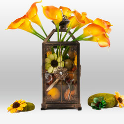 The Firefly Garden - Song Bird - Songbird is the perfect centerpiece for any indoor or outdoor environment. Our gorgeous Tulips or Calla Lilies come in a fresh palette of colors to match your style and event.