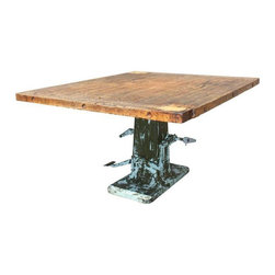 Pre-owned Vintage Wood and Metal Industrial Printer's Table - Ready for the Headlines!    This super cool vintage table is one of a kind.  The base is an old metal printing proof base. The top is over 50 years old and came off a bank locker in the metal shop of an old school. Together these unique finds have been repurposed into a unique and fabulous piece.  Would make a great retail display table or kitchen island.     Note: This piece is very large and heavy so please measure carefully.