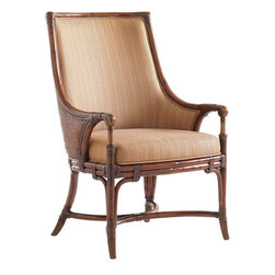Lexington - Tommy Bahama Home Landara Royal Palm Arm Chair - Woven raffia outside back with upholstered inside back featured in a woven pattern with highlights of sunset gold and cilantro green, set on a chestnut background makes this chair both romantic and inviting. Luxurious detailing throughout with leather strapped carved rattan to compliment the metal accents and ferrules finished in an antiqued brass patina. Shown in standard fabric, Seabrook, with custom fabric options available. See store for details.