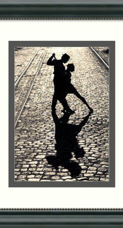 Amanti Art - The Last Dance Framed Print - Remember darlin', save the last dance for someone who really deserves to live forever in your memory. Captured in the last pose of the tango, the dancers on this print are forever entwined in a passionate embrace on a romantic, faraway cobblestone street. Surrounded by a custom frame with a white and grey mat, these dancers come ready to hang and full of emotion.