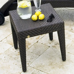 "Hospitality Rattan Soho Patio End Table - Rehau Fiber Java Brown - The Hospitality Rattan Soho Patio End Table - Rehau Fiber Java Brown offers a fully anodized aluminum frame which is woven with rehau java brown fiber. Its unique look and multi-colored textured surface make it one of the most attractive collections for any outdoor patio, deck or yard space. The end table is useful with any chaise lounge and can be used with the seating pieces. The resin wicker materials are weatherproof and UV-resistant to withstand inclement elements for years of use.About Hospitality Rattan Hospitality Rattan has been a leading manufacturer and distributor of contract quality rattan, wicker, and bamboo furnishings since 2000. The company's product lines have become dominant in the Casual Rattan, Wicker, and Outdoor Markets because of their quality construction, variety, and attractive design. Designed for buyers who appreciate upscale furniture with a tropical feel, Hospitality Rattan offers a range of indoor and outdoor collections featuring all-aluminum frames woven with Viro or Rehau synthetic wicker fiber that will not fade or crack when subjected to the elements. Hospitality Rattan furniture is manufactured to hospitality specifications and quality standards, which exceed the standards for residential use. Hospitality Rattan's Environmental Commitment Hospitality Rattan is continually looking for ways to limit their impact on the environment and is always trying to use the most environmentally friendly manufacturing techniques and materials possible. The company manufactures the highest quality furniture following sound and responsible environmental policies, with minimal impact on natural resources. Hospitality Rattan is also committed to achieving environmental best practices throughout its activity whenever this is practical and takes responsibility for the development and implementation of environmental best practices throughout all operations. Hospitality Rattan maintains a policy of continuous environmental improvement and therefore is a continuing work in progress. Hospitality Rattan's Environmentally Friendly Manufacturing Process All of Hospitality Rattan products are green. From its basic raw materials of rattan poles, peels, leather, bamboo, abaca, lampacanay, wood, leather strips, and boards, down to other materials like nails, staples, water-based adhesives, finishes, stains, glazes and packing materials, all have minimum impact to the environment and are safe, biodegradable, recycled, and mostly recyclable. Aside from this, the products have undergone an environmentally-friendly process that makes them """"greener."""" The company's rattan components are sourced from sustained-yield managed forests, which means the methods used to grow and harvest the rattan vines ensure the long-term life of the forest and protect the biodiversity of the forest's ecosystems. Hospitality Rattan is committed to buying and using all materials, from rattan and hardwood to finishing materials, from reputable and renewable suppliers and seeks appropriate evidence that suppliers are in compliance with this policy. Hospitality Rattan strives to use materials that are processed in an environmentally responsible manner, or consist of a high level of recycled material. Finishing materials and stains used in Hospitality Rattan's furniture products consist of 75% water-based solutions which evaporate upon application with reduced or Volatile Organic Compounds (VOCs). The furniture factories use water-based glues, stains, topcoats and other finishes on all of their products. The switch from traditional solvent-based processes to water-based processes involved consolidating several processes by the factories, resulting in an 85% reduction in VOC emissions."