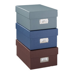 "Exposures - Signature Photo Storage Box - Overview Keep photos, art projects and other important papers organized and protected in these versatile photo storage boxes. Sturdy construction, more than 30% thicker than other boxes in the marketplace, decorative storage boxes ensure your precious mementos are protected. Label holders help you know the content of each box without having to look inside. Our Signature storage boxes are specially designed to fit Exposures storage furniture, allowing you to keep your boxes in a convenient location. The neutral color palette complements many dcor styles.  Features Colored paper covering Silver nickel label holder Storage box holds up to 1,000 4"" x 7"" photos  Made in the USA     Specifications  Storage box is 8 1/2"" wide x 5 1/16"" high x 11 3/4"" deep"