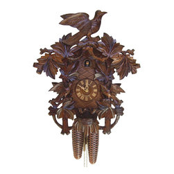Schneider Cuckoo Clocks - 8-Day Wooden Cuckoo Clock in Mahogany Finish - Carved style. Night shut-off switch. Extra deep and detailed carving. Deep carving of birds and flowers. Casing with structure at both sides. 8-day rack strike movement. Wooden cuckoo calls and strikes every half and full hour. On clocks with music and dancing couples. Pretty hand-painted wood dancers. Wooden cuckoo, dial with roman numerals and hands. Shut-off lever on left side of case silences strike, call and music. Made from wood. Made in Germany. 13.4 in. W x 7.5 in. D x 16.5 in. H (11 lbs.). Care Instructions