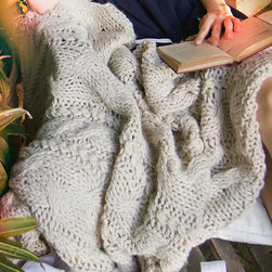 Throw - Manhattan - Oyster - A warm wool-acrylic blend in the yarn of the Manhattan Throw gives practicality to an accent piece that's already desirable for its sheer beauty.  Elegantly and traditionally cable-knit, this oyster-colored throw recalls favorite Irish sweaters and rejuvenating vacations.  An urbane note in a rustic room and a quaint, cozy addition in a more transitional one, this knit throw is large enough to curl up with and has a wondrous texture when flowing over the arm of a loveseat or tossed casually on a chaise.