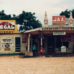 """Cross Roads Store, Bar, """"Juke Joint,"""" Melrose, La. Print - A cross roads store, bar, """"juke joint,"""" and gas station in the cotton plantation area, Melrose, La. Photographed by Marion Post Wolcott in June of 1940.Summary: Photograph shows Sign on left building: Frenchies Beer Garden; above porch: Frenchies Bar."""