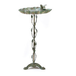 KOOLEKOO - Verdigris Leaf Birdbath - Balanced at the edge of a broad green leaf, a sparrow lifts his voice in a joyous springtime song. Distressed finish gives this handsome metalwork birdbath the appearance of a well-weathered antique. An enchanting garden decoration that serves as a welcome watering stop for thirsty birds!