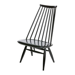 Artek - Mademoiselle Lounge Chair by Artek - Take a load off. A distinctive design by Ilmari Tapiovaara, the Artek Mademoiselle Lounge Chair features an irresistible leaned-back look. Its birch wood composition is stained in black or painted white, making it a versatile chair for both formal and casual settings. Founded in Finland in 1935 by four self-proclaimed idealists, Artek stands strong on the company's ethics, product aesthetics and ecology. With products that offer the Scandinavian look--clean lines, minimal fluff--Artek has built a line that incorporates a modern, approachable appeal into modern furniture and lighting design.The Artek Mademoiselle Lounge Chair is available with the following:Details:Made of birch woodMade in FinlandDesigned by Ilmari Tapiovaara, 1956Options:Color: Black Stained, or White Painted.Shipping:Black Stained usually ships in 10 business days; White Painted usually ships in 12-14 weeks.
