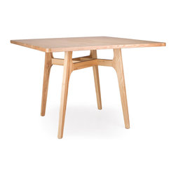 Inova Team -Rustic Wood Dining Table - Take a look under the square top of this handsome ash wood table. You'll find that the sleek beg legs come together in a modern, minimalist version of a Celtic knot, giving it a surprising touch of intricate style.